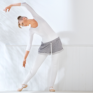 A woman performs ballet as exercise.