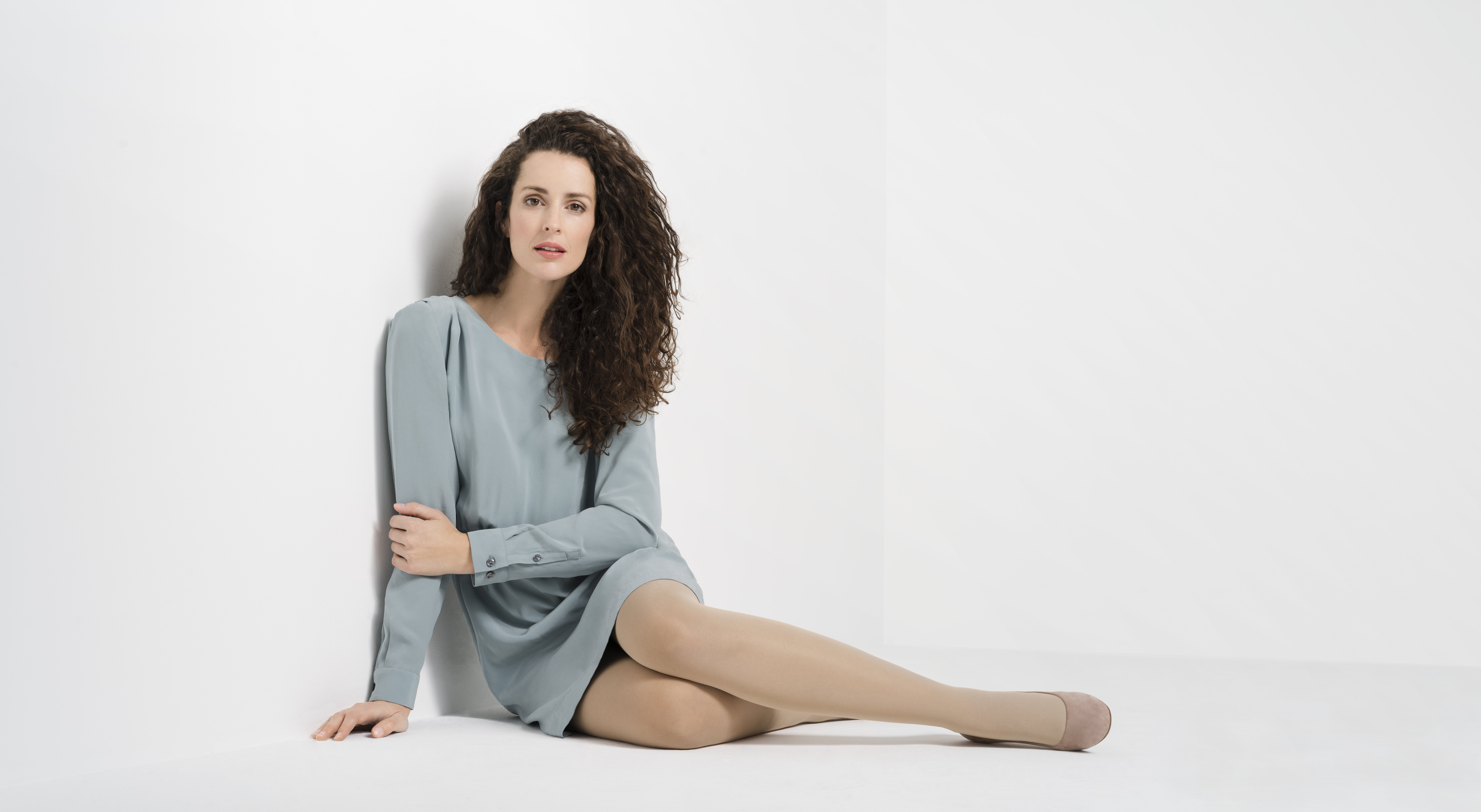 A woman in compression stockings.