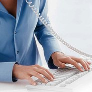 A woman types on a keyboard.