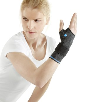 A woman uses a wrist support.